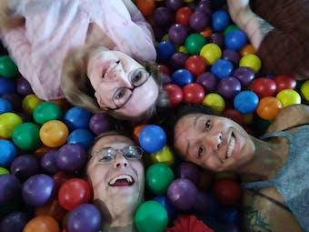Adults enjoying a ball pit