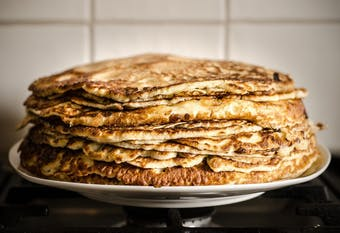 Large stack of pancakes on a plate